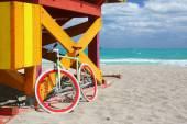 Lifeguard cabin and cool bike — Stock Photo