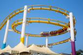 Colorful roller coaster rides on loop — Stock Photo