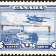 Seaplane and steamboat on postage stamp — Stock Photo #78203372