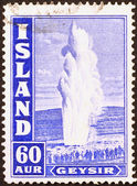 Geyser and crowd of people on postage stamp — Stock Photo