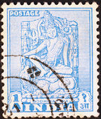 Bodhisatwa statue on postage stamp — Стоковое фото