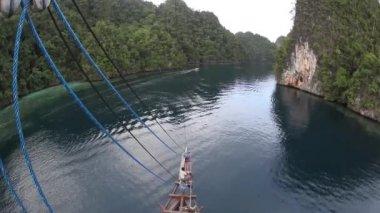 Schooner cruises through a channel in Raja Ampat — Stock Video