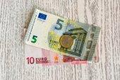 Euro banknotes and euro coins — Stock Photo