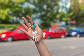 Salesman giving car key to a new owner — Stock Photo