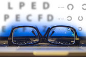 Glasses on laptop keyboard — Stock Photo