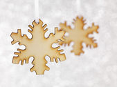Wooden Snowflake on silver — Stockfoto