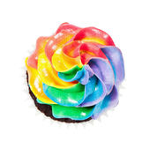 A colourful cupcake with rainbow buttercream icing — Stock Photo