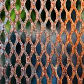 A metal grate with a rusty texture. — Stock Photo