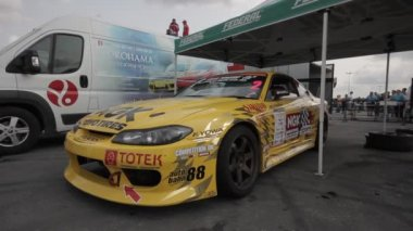 Yellow racing car on the parking - filmed with dolly — Video Stock