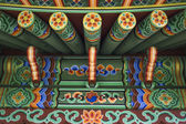 Green Chinese ethnic painted wooden blockhouse background — 图库照片