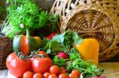 Tomatoes, radishes, peppers, parsley and wickerwork handbasket — Stock Photo