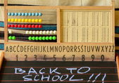 Back to school. Abacus, blackboard, alphabet and numbers. — Stock Photo