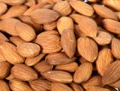 Pile of almonds as background — Stock Photo