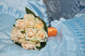 Wedding bouquet with roses on blue background — Stock Photo
