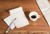 Writing with a cup of coffee. — Stock Photo