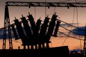 Power line with transformer at sunset — Stock Photo