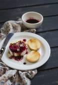 Sheep cheese with berry sauce, nuts and balsamic vinegar — Stock Photo