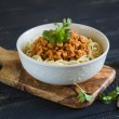 Pasta with meat sauce in a white bowl — Stock Photo #75313353