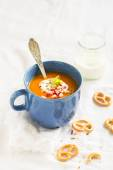 Pumpkin soup served in blue ceramic mug with cream and paprika — Stock Photo