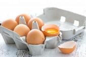 Cardboard box with eggs on wood — ストック写真