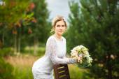 Beautiful young bride in the summer park — Стоковое фото