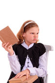 Portrait of a schoolgirl with a book uninteresting — Stock Photo