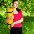 Girl holding yellow sport  and going to the yoga class — Stock Photo #73004691