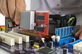 Technician's hands Installing VGA card — Stock Photo