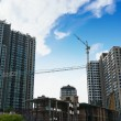 Tower crane on buildings under construction — Stock Photo #73379071