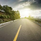 Mountain road at dusk — Foto Stock