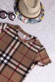 Children cloth  hat and sunglasses — Stock Photo