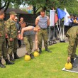 Постер, плакат: Soldiers contract employees carry out power exercises with weights