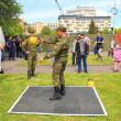 Постер, плакат: Soldiers employees carry out power exercises with weights