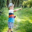 Adorable little boy pointing at something — Stock Photo #75666763