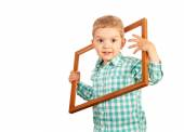 Kid hold wooden picture frame on white background — Stock Photo
