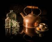 Still life antique brass tea pot, cup, flower — Stock Photo
