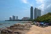 Small beach among skyscrapers — Stock Photo