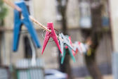 Colorful clothespins hanging on rope — Stock Photo