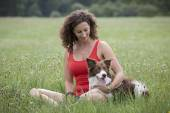 Dog and woman in a meadow — Stock fotografie