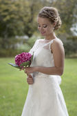 Bride with flowers in the garden — Stock Photo