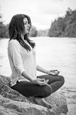 Meditation at the riverside — Stock Photo