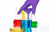 Science Laboratory glassware pipette drop, reflective white back — Stock Photo