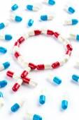 Red capsule and blue capsule in Gender Symbol, women's Health — Stock Photo