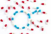 Red capsule and blue capsule in Gender Symbol, Men's Health — Stock Photo