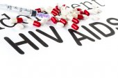 Capsule and Syringe on paper, AIDS,HIV, medication sickness — Stock Photo