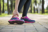 Woman runner hold twisted ankle Pain ,Human Leg — Stock Photo