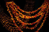 Amber beads in the narket — Stock Photo