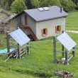 Mountain chalet with solar panels — Stock Photo #78230274