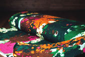 Colorful textile roll with flowers on wooden background — Stock Photo