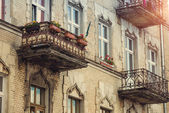 House with flowers on the balconies — Stock Photo